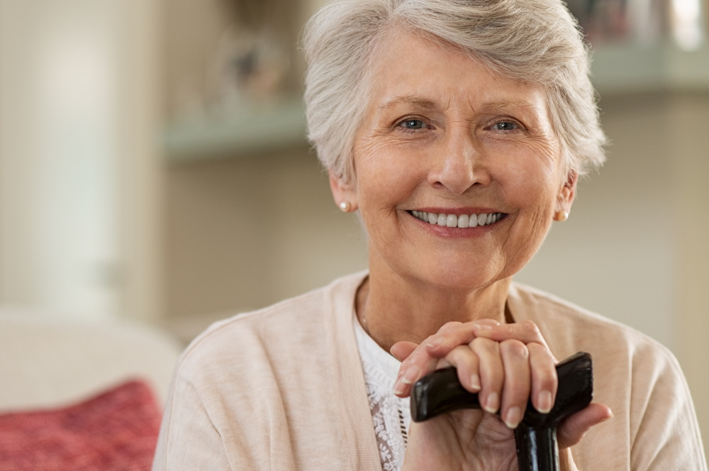 older woman smiling - Taking Care of Your Oral Health Through Your Golden Years